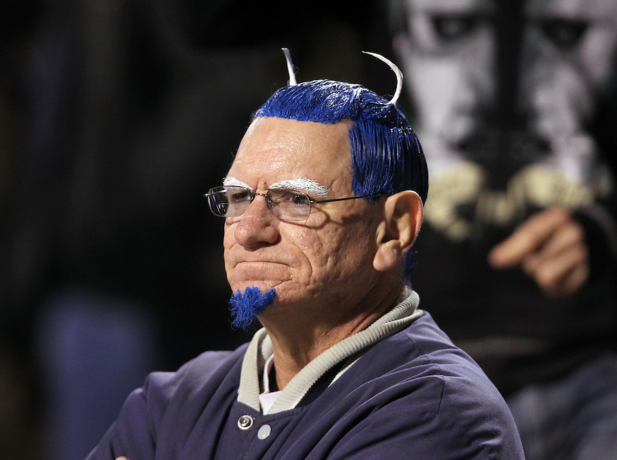 CHARLOTTESVILLE, VA- NOVEMBER 12: A Duke Blue Devil fan watches with his hair painted school colors during the game against the Virginia Cavaliers on November 12, 2011 at Scott Stadium in Charlottesville, Virginia. Virginia defeated Duke 31-21. (Photo by Andrew Shurtleff/Getty Images) *** Local Caption ***