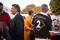 Argyle Pink Diamonds Managing Director Nik Senapati (left) shares a laugh with other guests as a Western Australia Polo Team player (right) has some refreshments at the high tea event after the Argyle Pink Diamond Cup, organised as part of the 2013 Oz Fest in the Rajasthan Polo Club grounds in Jaipur, Rajasthan, India on 10th January 2013. Photo by Suzanne Lee