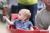Devyn Littleton, 15 months, of Bellingham, eats a corndog during a performance at the NW Washington Fair on August 21, 2009. PHOTO BY MERYL SCHENKER ....