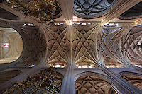 Ceiling of Gothic choir, 15th century, with tracery and high columns, Segovia Cathedral, (Catedral de Segovia, Catedral de Santa Maria), 1525-77, by Juan Gil de Hontanon (1480-1526), and continued by his son Rodrigo Gil de Hontanon (1500-1577), Segovia, Castile and Leon, Spain. Last Gothic Cathedral in Spain, commissioned by Carlos V (1500-58), after an earlier cathedral was damaged in the Revolt of the Comuneros, 1520. Cathedral consecrated, 1768. Ground plan has three naves surrounded by chapels. The interior is lit by Flemish windows, 16th-17th century, and centres on Gothic choir (15th century). Picture by Manuel Cohen
