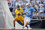 29 MAY 2011:  D.J. Hessler (28) of Tufts University moves the ball against Collin Tokosch (47) of Salisbury University during the Division III Men's Lacrosse Championship held at M+T Bank Stadium in Baltimore, MD.  Salisbury defeated Tufts 19-7 for the national title. Larry French/NCAA Photos