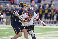 College Park, MD - April 1, 2017: Maryland Terrapins Matt Neufeldt (28) tries to knock the ball loose during game between Michigan and Maryland at  Capital One Field at Maryland Stadium in College Park, MD.  (Photo by Elliott Brown/Media Images International)