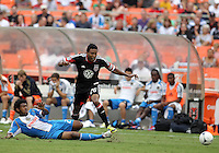 WASHINGTON, D.C. - AUGUST 19, 2012:  Lionard Pajoy (26) of DC United has the ball slid away from him by Sheanon Williams (25) of the Philadelphia Union during an MLS match at RFK Stadium, in Washington DC, on August 19. The game ended in a 1-1 tie.