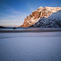 Winter sunset over Bunes beach, Moskenesøy, Lofoten Islands, Norway