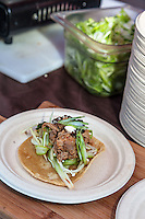 Chef Matt Basile of Fidel Gastro serves up PeKing Elvis Sandwich: a Butter Grilled Pita featuring Spicy Orange Duck Meat (or Grilled Golden Beets) with Green Onion and the King's Secret Sauce at FoodShare Toronto's Recipe for Change, February 28,  2013
