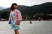 A young girl in a town in Pingwu County in Sichuan Province, south-west China.