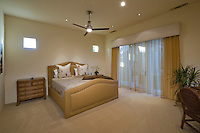 Contemporary bedroom with large windows covered by sheer draperies