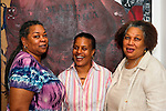 Three women friends, members of Citified Book Club, at African American Museum of Nassau County, for Family Portrait Day, an event by the Long Island Center of Photography, at Hempstead, New Yor, USA, on September 17, 2011. The three senior women are posing in front of painting by black artist. (EDITORIAL USE ONLY)