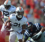 Auburn running back Tre Mason (21) is chased by Mississippi defensive lineman Issac Gross (94) at Vaught-Hemingway Stadium in Oxford, Miss. on Saturday, October 13, 2012. (AP Photo/Oxford Eagle, Bruce Newman)..