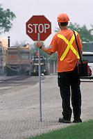 Flagman on Road Resurfacing Project - Facing Away