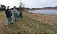 NWA Democrat-Gazette/FLIP PUTTHOFF <br />The Beaver Lake Nursery Pond, where the Arkansas Game and Fish Commission raises fish, is a haven for bird watching, nature study and easy hiking. Terry Stanfill (from left) David Oakley and Joe Neal eye several species of ducks on March 23 2017 during a visit to the 30-acre pond adjacent to Beaver Lake.