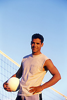 Handsome male with volleyball.