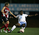 UNC's Robyn Gayle (11) and NCSU's Lindsay Vera (13) challenge for the ball on Thursday, October 20th, 2005 at Fetzer Field in Chapel Hill, North Carolina. The University of North Carolina Tarheels defeated the North Carolina State University Wolfpack 1-0 during an NCAA Division I Women's Soccer game.