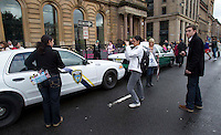War Z Film film set in Glasgow as Strathclyde police officer looks at the American police cars parked in Glasgow's George Square as filming starts on the Brad Pitt's new film..Picture: Universal News And Sport (Scotland). 16 August 2011. www.unpixs.com..