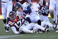Nov 27, 2010; Charlottesville, VA, USA;  Virginia Tech Hokies cornerback Kyle Fuller (17)and Virginia Cavaliers quarterback Ross Metheny (15) during the game at Lane Stadium. Virginia Tech won 37-7. Mandatory Credit: Andrew Shurtleff