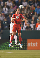 CARSON, CA – June 3, 2011: DC United midfielder Chris Pontius (13) goes high to head the ball during the match between LA Galaxy and DC United at the Home Depot Center in Carson, California. Final score LA Galaxy 0, DC United 0.