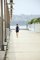 A man cooling down on Woolloomooloo Wharf following an evening run