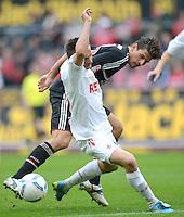 FUSSBALL   1. BUNDESLIGA  SAISON 2011/2012   34. Spieltag 1. FC Koeln - FC Bayern Muenchen        05.05.2012 Mario Gomez (re, FC Bayern Muenchen) gegen Slawomir Peszko (1 FC Koeln)