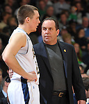 Notre Dame Fighting Irish head coach Mike Brey talks with guard Pat Connaughton (24).