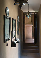 A corridor is lit by traditional North African star-shaped metal lanterns