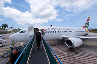 Grand Cayman. Owen Roberts International Airport, George Town. Nicole Schmidt boarding a Cayman Airways Boeing 737.
