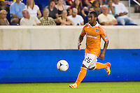 Corey Ashe (26) of the Houston Dynamo. The New York Red Bulls defeated the Houston Dynamo 2-0 during a Major League Soccer (MLS) match at Red Bull Arena in Harrison, NJ, on August 10, 2012.