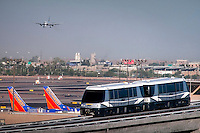 The Phoenix Sky Harbor Sky Train carries passengers between parking and Terminal 4 at the major southwestern airport. Sky Harbor Airport added a Skytrain to the facility to connect parking structures and the terminals to reduce traffic and make passenger movement within the busy airport easier. The first phase of the project opened in 2013 connecting east parking to terminal 4, with a second phase connecting the rest of the terminals by 2015. The taxiway bridge is tall enough to accomodate a 747.