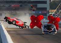Sep 23, 2016; Madison, IL, USA; NHRA pro mod driver Jay Payne goes airborne as he crashes alongside Chuck Little during qualifying for the Midwest Nationals at Gateway Motorsports Park. Payne walked away from the accident. Mandatory Credit: Mark J. Rebilas-USA TODAY Sports