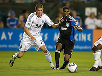 Khari Stephenson of Earthquakes controls the ball away from Greg Janicki of WhiteCaps during the game at Buck Shaw Stadium in Santa Clara, California on July 20th, 2011.  Earthquakes and WhiteCaps are tied 2-2 at the end of the game.