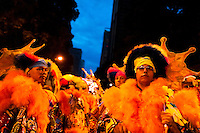 Brazilian men, dressed in fancy costumes, perform during the carnival street party in Rio de Janeiro, Brazil, 21 February 2012. Most of the carnival street parties in Rio are organized and run by Blocos. Each Bloco consists of a musical band and a group of partygoers. The Blocos, closely linked to the neighborhoods they come from, start their free-to-join parades early in January and continue throughout the carnival season. Playing usually their own samba song, backed up with a numerous bateria (drum and percussion players), Blocos are considered the beating heart of the Rio Carnival.