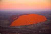 Ayers rock at sunrise      Uluru/Kata Juta National park, Australia     Red Center of Northern Territory   Huge Monolith in Australian desert