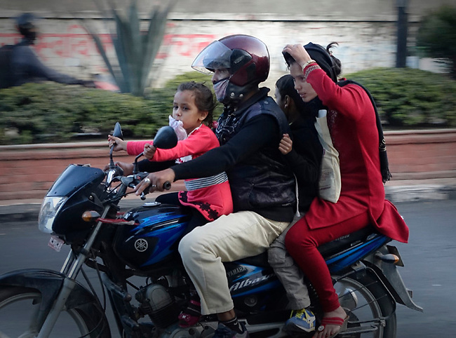 Family on motorcycle, Patan, Nepal