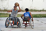 Manuel Rios (left) grabs the basketball during practice in Zipolite, a town in Oaxaca, Mexico. Rios plays on the Oaxaca Costa wheelchair basketball team. Rios and Bartolome Martinez (right) play for the Oaxaca Costa wheelchair basketball team.