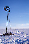 Windmill on Snowy Farm Field