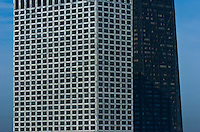 """Symmetrical patterns created by windows, the darker one being the Hancock building.  The architecture of Chicago has influenced and reflected the history of American architecture. The city of Chicago, Illinois features prominent buildings in a variety of styles by many important architects. Since most buildings within the downtown area were destroyed by the Great Chicago Fire in 1871, Chicago buildings are noted for their originality rather than their antiquity..Beginning in the early 1880s, architectural pioneers of the Chicago School explored steel-frame construction and, in the 1890s, the use of large areas of plate glass. These were among the first modern skyscrapers and amongst their most famous architects were William LeBaron, John Wellborn Root Sr., Daniel Burnham and Charles Atwood. Louis Sullivan was perhaps the city's most philosophical architect. Realizing that the skyscraper represented a new form of architecture, he discarded historical precedent and designed buildings that emphasized their vertical nature. This new form of architecture, by Jenney, Burnham, Sullivan, and others, became known as the """"Commercial Style,"""" but it was called the """"Chicago School"""" by later historians..Since 1963, a """"Second Chicago School"""" emerged, largely due to the ideas of structural engineer Fazlur Khan. Some of Chicago's skyscrapers such as the John Hancock Center, Willis Tower (formerly known as the Sears Tower) and The Trump International Hotel and Tower are amongst the tallest buildings in the world."""