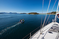 Dinghy takes sailboat crew to land on small island near Sommarøy, Norway
