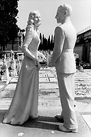 "Italy. Tuscany. Florence. Cemetery "" Cimiterio monumentale di San Miniato al Monte"". Marble statues of a couple. A man and a woman. Florence is the capital city of the Italian region of Tuscany and of the province of Florence. It is the most populous city in Tuscany, with approximately 370,000 inhabitants, expanding to over 1.5 million in the metropolitan area. © 1993 Didier Ruef"