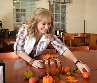 NWA Democrat-Gazette/BEN GOFF @NWABENGOFF<br /> Jamie Davis helps decorate tables on Monday Nov. 23, 2015 before the Youth Bridge Thanksgiving meal at Golden Corral in Rogers. Davis is event chair for Somewhere South of St. Somewhere, the annual fundraising gala for Youth Bridge.