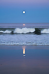 The full Hunter's Moon rising over the surf at Nauset Beach in Orleans.