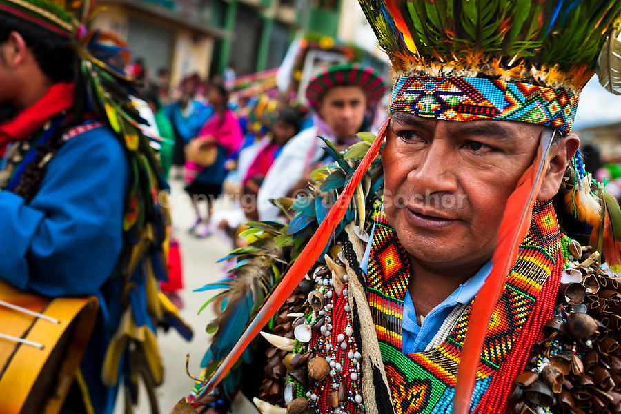 """A Colombian Kamentsá shaman, wearing a colorful costume, takes part in the Carnival of Forgiveness, a traditional indigenous celebration in Sibundoy, Colombia, 12 February 2013. Clestrinye (""""Carnaval del Perdón"""") is a ritual ceremony kept for centuries in the Valley of Sibundoy in Putumayo (the Amazonian department of Colombia), a home to two closely allied indigenous groups, the Inga and Kamentsá. Although the festival has indigenous origins, the Catholic religion elements have been introduced and merged with the shamanistic tradition. Celebrating annually the collaboration, peace and unity between tribes, they believe that anyone who offended anyone may ask for forgiveness this day and all of them should grant pardons."""