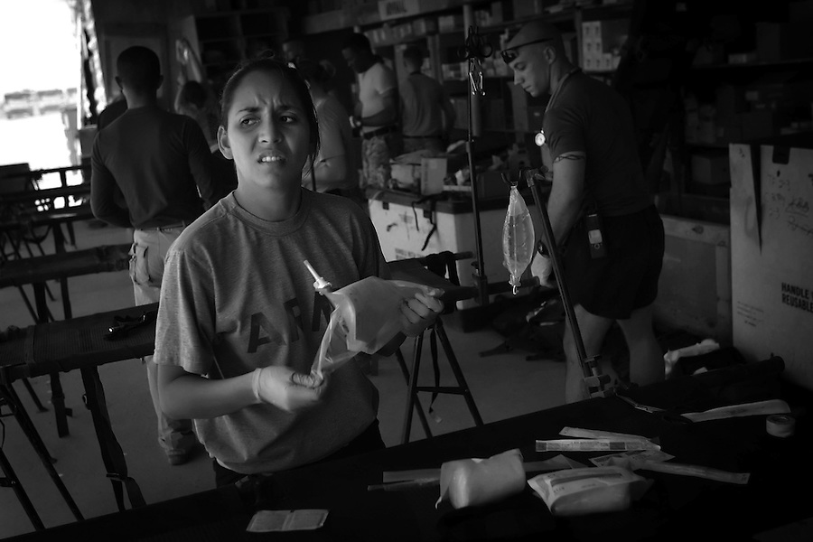 Army medic SPC Yrina Sanchez prepares for in-coming wounded at Ramadi Surgical - a joint Army-Naval surgical unit at Camp Ramadi on Thursday August 10, 2006. For its size the surgical unit is the busiest in the country.&amp;#xA;<br />