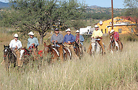 13 Horsemen who started out from Nogales organized by Salvador Camarena Rodriguez, a Nogales rancher who for the past ten years has invited friends and neighbors to ride along to Magdelina. Tucsonians who rode along with the Nogales cowboys were  John Ochoa age 44 (red shirt rear) and Bob Miles 44 ...