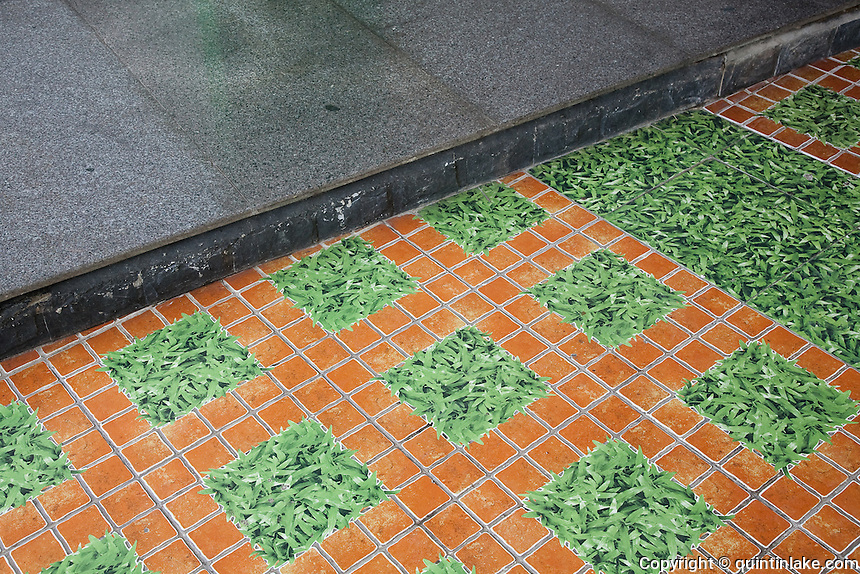 Verdant floor tiles in the Green Hotel,  Hue, Vietnam
