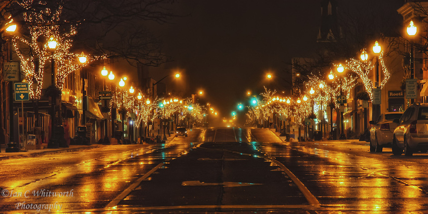 Looking along Lakeshore in downtown Oakville at the Christmas lights at night.