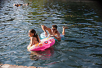 Local Austin couple enjoys Barton Springs Pool, Austin's favorite swimming hole. Located on the edge of Zilker Park its a great place to escape the heat and enjoy the outdoors.
