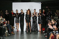 Fashion designer Eva Minge, poses with models at the close of her DNA Minge range Fall/Winter 2011/2012 collection runway show, during New York Fashion Week Fall 2011.