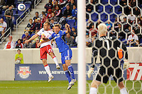 Joel Lindpere (20) of the New York Red Bulls and Jimmy Conrad (12) of the Kansas City Wizards go up for a header. The New York Red Bulls defeated the Kansas City Wizards 1-0 during a Major League Soccer (MLS) match at Red Bull Arena in Harrison, NJ, on October 02, 2010.