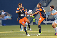 Marco Estrada (13) midfield Montpellier, Jamel Saihi (23) midfield Montpellier..Sporting Kansas City were defeated 3-0 by Montpellier HSC in an international friendly at LIVESTRONG Sporting Park, Kansas City, KS..