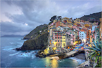 Morning time is my favorite time of day in the Cinque Terre. If you arise before sunrise, you'll be treated to amazing light and scenes and pretty much have the towns to yourself, as I did in making this image of Riomaggiore. You may run into the locals finishing up fishing for the night, or the local fish dealers laying out the night's catch on ice. The clouds can often add drama to the morning, as well. ..So grab your favorite beverage and a hot pastry from the local bakery, and you'll be set for sunrise.