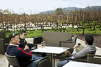 USA. California state. Napa valley. Three men from Thailand are tasting wine at Robert Mondavi Winery, To Kalon Vineyard. View on the Oakville vineyards and the Mayacamas hills. Robert Gerald Mondavi (June 18, 1913 – May 16, 2008) was a leading California vineyard operator whose technical improvements and marketing strategies brought worldwide recognition for the wines of the Napa Valley in California. 16.12.2014 © 2014 Didier Ruef